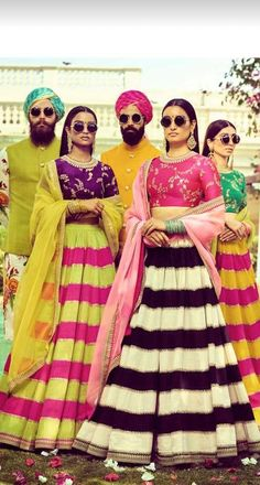Big Stripes in bold colours for lehengas paired with contrasting tilla work raw silk blouses make for an eye-catching destination wedding outfit. // indian reception outfits with unique lehenga choli patterns Indian Reception Outfit, Wedding Reception Outfit, Indian Wedding Outfits, Indian Outfits, Bridal Outfits, Wedding Attire, Choli Pattern, Sabyasachi, Lehenga Choli