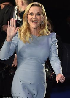 Greetings: Reese offered onlookers a cheerful wave...