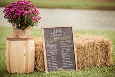 Greet your guests with a chalkboard wedding menu propped up by bales of hay.