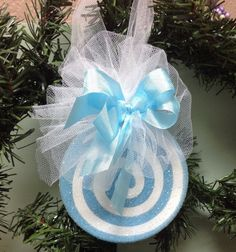 Darling pastel blue Candy Christmas Ornament. Measuring a large 3 1/2 inches across this really makes a statement on your Christmas tree, Wreath, or Mantel decoration. I create with love and ship with care. This ornament will be shipped in a box with padding to assure safe arrival to your home. I can put multiple bulbs in one box for the shipping cost.  I am sure you will love your purchase but if for any reason you are not completely just contact me within 7 days to receive a full refun...
