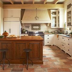 Wood and Cream.  Temper an all-white kitchen with touches of other colors and textures. The brick niche and natural wood island in this kitchen warm up the look and feel of the space