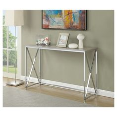 Deliver modern styling and plenty of shine to your room with this Belaire console table. This rectangular table sports a chrome finish and X-shaped end frames for a clean, lean look. Belaire console t Decor, Furniture, Silver Console Table, Top Sofas, Contemporary Console, Table, Home Decor, Versatile Table, Contemporary Console Table