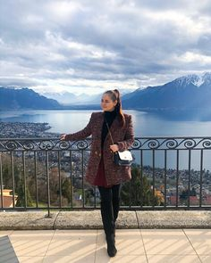 CHLOE.ROXANE - Switzerland : Enjoying the beautiful view over Montreux, Switzerland from the hotel Mirador. Also loving my wintery outfit featuring a colorful bouclé coat that reminds me of a Chanel jacket, my all-black outfit and my Night&Day bag by De Marquet.