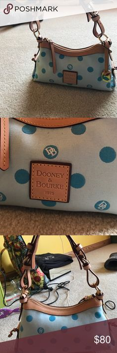 Small shoulder purse Light blue background with dark blue polka dots. Pink interior and light brown leather strap. Like new, barely used. Dooney & Bourke Bags Shoulder Bags