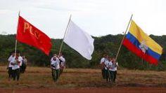 Des membres des Farc défilent lors de leur congrès annuel, le 23 septembre 2016, près d'El Diamante(Colombie). | JOHN VIZCAINO / REUTERS