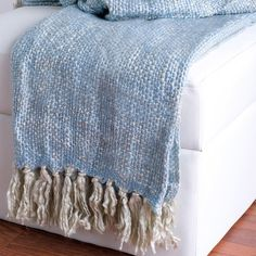 Perfect for evenings outside or relaxing in front of the fire, this loom-woven throw features a blue and cream design with fringed trim.