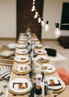 the perfect friendsgiving tablescape decorations on a budget with catered olive garden // floor seating for a nice girl's dinner