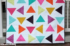 little miss shabby quilt - love the variety of how the triangles are quilted.
