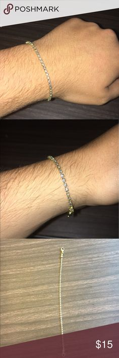 Men's bracelet Men's bracelet not real gold or diamonds. Let me know if you have any questions Diamond & Gold Accessories Jewelry