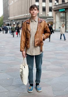 """Atte, 18    """"I'm wearing a second hand leather jacket from Karstula, a vintage Wrangler shirt, Cheap Monday jeans and Vans shoes which I bought from my friend for a pizza.  I like mixing vintage, 50s influences and not-so-neat clothes. I like old, used clothes."""""""