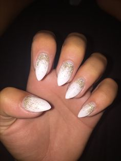 White stiletto nails with gold ombré accent