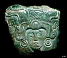 Maya. jade. height 6.2 cm. Pendant, portrait wearing headdress with crossed bands.
