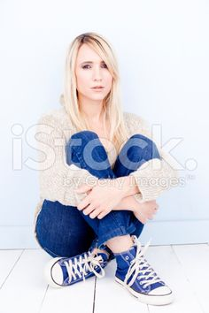 Blonde Woman Sitting Relaxed On The Floor royalty-free stock photo