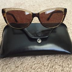 Auth LIMITED EDITION FENDI sunglasses Mint and comes with Fendi case. Worn a couple of times and they've been stored for a while. Case may show faint scuffs caused by storage. Frame is tortoise shell and the crystals are yellow. This cat eye model has been worn by Katy Perry. Stunning! FENDI Accessories Glasses