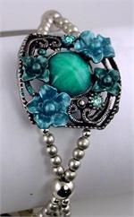 Beautiful bracelet made up of slider beads and fold over magnetic clasps.  www.mobile-boutique.com