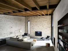A Spanish Architect Transforms a Medieval Townhouse Into a Stunning Rental - Photo 8 of 14 - Contemporary materials—such as concrete and steel—are a wonderful contrast to the ancient stone walls.