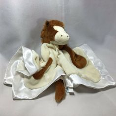 The super soft baby blanket has the head of a spotted horse at its center. Soft satin on back of blanket. That's right, it doubles as a plush spotted horse with baby safe embroidered facial features. Baby Boy Bibs, Baby Lovey, Baby Toys, Baby Security Blanket, Lovey Blanket, Plush Baby Blankets, Pink Giraffe, Patchwork Baby, Baby Horses