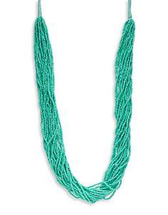 "<ul> <li>A dramatic statement necklace drenched in colorful sea beads</li> <li>Plastic/textile</li> <li>Length, about 30""</li> <li>Drop, about 3""</li> <li>Imported</li> </ul>"