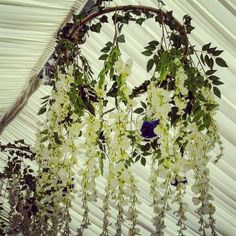 Hula hoop ceiling hangings with ivy, wisteria and blue roses in glass baubles. Were a challenge but 100% worth the effect!