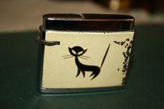 """Vintage Fisher """"Kitten"""" Lighter. $8.00, via Etsy."""