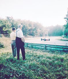 Enzo Ferrari watching one his cars go by