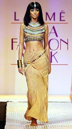 Egyptian - History of Fashion Egyptian inspired, draped skirt. Possiam based top, head accessory and heavy eye make-up.