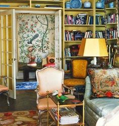 Colorful living room - french doors, bookshelves, needlepoint rug, hand painted walls - Mary Jane Pool from Domino Magazine - March 2008