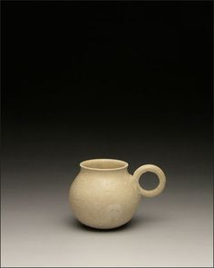 A white glazed cup with handle. 618– ca. 906, Tang Dynasty. Ulricehamn East Asian Museum,