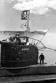 SUB ~ The submarine Polish Sokół back to its base in 1944. They are well visible the Jolly Roger and two Nazi flags captured ~ BFD