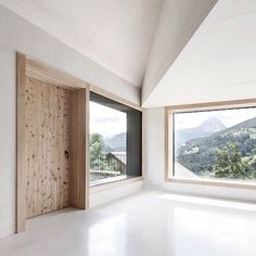 Inside the dark facade of these farmhouse-inspired cabins in North Italy lie a pair of bright holiday homes. These alpine cabins by Pedevilla Architekten invited the outside in by cladding their windows and doors in swiss pine, framing the surrounding views with natural and large low windows to create a vast sense of space and light within these small cabins. #triibetips #wearetriibe