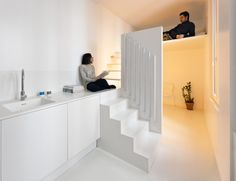 The Spectral Apartment by Betillon/Dorval-Bory Architects is a renovation of a 215-square-foot flat on the outskirts of Paris. Designed around the need to maximize natural light, the all-white interior features a mezzanine with a stairway leading up to a sleeping nook that conceals the sink and shower below.