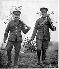 Christmas at the Front: British soldiers bringing in mistletoe. December 1914.