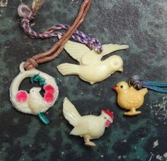 Hey, I found this really awesome Etsy listing at https://www.etsy.com/listing/228940842/vintage-celluloid-charms-bird-chicken