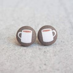 These coffee cup earrings are made by hand and are just perfect birthday gifts or bridesmaid gifts. Original, cute and whimsical; priced to gift and collect! Earring measures approx .5 inch wide and has a hypoallergenic, raw titanium post. Fabric buttons are made of 100% cotton, hand stretched (by me) over an aluminum dome. Ships 2-5 days from USA Made in USA Gift Box Nickle Free Titanium Hypoallergenic .5 inches Button Earrings, Etsy Earrings, Fabric Earrings, My Coffee, Coffee Cups, Cool Gifts, Best Gifts, Coffee Lover Gifts, Coffee Lovers