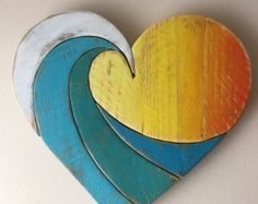 ***THIS HEART IS READY TO SHIP NOW ***  Our Beach cottage inspired heart is hand painted with pastel pinks, blues, turquoise and whites. This unique rustic heart is designed and made by hand in our shop using reclaimed wood. The boards are chosen individually, then each carefully hand painted and sanded to create a the visual appeal of vintage texture and color. The boards are secured by both wood glue and nails with added boards on the backside for reinforcement. It is coated with several…