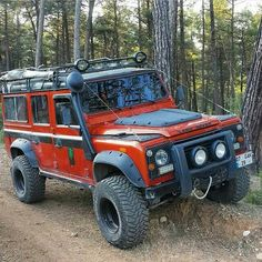 Orange is the new black in the world of Land Rover. Love the old army helmet on the snorkel