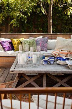 Outdoor Area: Bench Seating + Patterned Pillows | Estee Stanely's LA Home