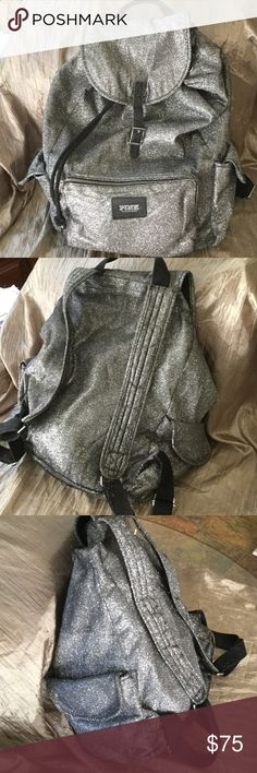 Rare Victoria's Secret Silver Backpack Wow, This is an iconic Victoria's Secrets Backpack !  Great condition,  Pink, Bombshell and you.  Grab it and growl,  you'll get all the looks and go on great trips while being oh so slick,  yeah baby you're that chick ! Victoria's Secret Bags Backpacks