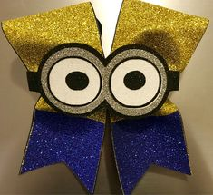 Cheer bow modeled after an adorable minion. Layered vinyl centerpiece that is soft and flexible. Cheer Quotes, Gift Bows, Cheer Bows, Cheerleading, Minions, Inspired, Cheers, Celebration, Gifts