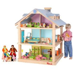 Now THAT'S a dollhouse.  (And I love that there's a little BOY in this picture!)