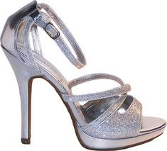 Glitter platform with adjustable ankle strap ensuring secure fit at all times. Criss-cross strap at the toe. Padded and cushioned insole ensuring comfort. This shoe has a .75  platform height.