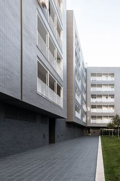 Rome-based studio Alvisi Kirimoto has created an affordable housing complex with a brick facade and perforated metal balconies to help regenerate a neighbourhood in Barletta, Puglia. Grey Brick, Perforated Metal, Brick Facade, Social Housing, Affordable Housing, Brickwork, Ceiling Windows, Urban Planning, Skylight