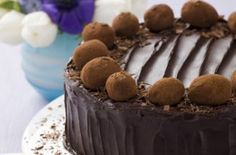Chocolate truffle cake  Top your chocolate cake with even more chocolate! Homemade truffles will add a special finish to your cake. This one arranges them in the classic Simnel design for Easter but you can cover it with them if you want to