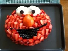 No, Elmo will not be making an appearance ;-P But I like this idea for using strawberries to cover the cake- no food colouring or red dyes required!