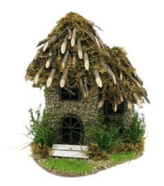 Start a new fairy garden project with the magical Bloom Room Littles Fairy Garden Twig Roof House. This lovely miniature house has impressive stone walls and charming black window frames. The roof is