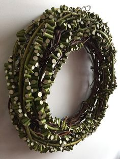 Prometheus: Textural wreath of grape vine with shrub dogwood branches cut and strung then wound around.