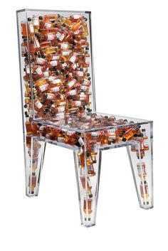 BRC Designs: Impractically Comfortable Side Chair - Clear acrylic is bound together forming the shape of a side chair. The entire chair forms a hollow inner cavity which is filled with 282 mini bottles of southern comfort. Limited Edition of five