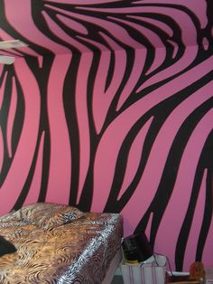 Super cool pink and black zebra walls painted by Chris w/ withtheflowartstudios.com