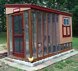 screened coop with predator protection