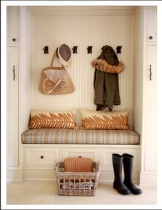 Mudroom in the kitchen, easy to replicate in a rental with closet maid skinny bookcase on its side and also coat hooks. Cushion on bookcase side and a basket in one shelf to store hats/ gloves/ ect!!